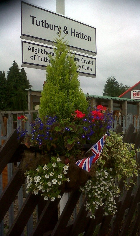 Colourful planters by the station volunteers to celebrate the Queen's Jubilee